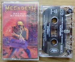 аудиокассета MEGADETH ''Peace Sells… But Who's Buying?'' (1986 USA press, digalog sticker, 4XT-12526, ex+/ex) (MC2066)