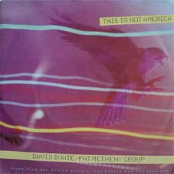 винил LP DAVID BOWIE + PET METHENY GROUP ''This Is Not America (Theme From ''The Falcon And The Snowman'' OST)'' (7''single)(1985 German press, mint/ex)