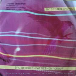 "винил LP DAVID BOWIE & PAT METHENY GROUP ""This Is Not America - This Is Not America (Instrumental)"" (7""single) (1985 German press, ex/ex)"